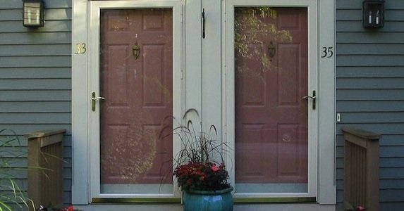 What are the benefits of installing a storm door?